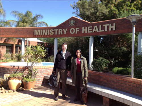 Dr. Richard Bucala (left) and Dr. Rita Das (right) in front of the Botswana Ministry of Health. Dr. Rita Das received her PhD for unearthing the association between MIF allele and TB susceptibility. Courtesy of Dr. Bucala.