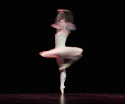 A ballerina spins rapidly in her execution of a pirouette. Courtesy of Leon Neal.