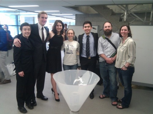 Members of the student group, along with Subalusky and Dutton, with their meter housing design. Courtesy of Amana Subalusky and Christopher Dutton.