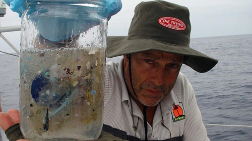 Captain Moore, posing with a water sample taken from the Great Garbage Patch. Courtesy of Algalita Marine Research Foundation.
