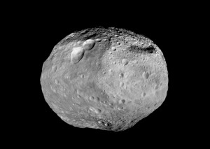 Some scientists believe the composition of NWA 7325 more closely resembles that of the main asteroid belt, such as asteroid Vesta seen here. Image courtesy of NASA