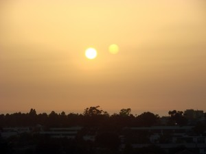 In binary systems, the central star is often much brighter than the secondary star. This is a picture of what sunset could look like from a planet in a binary system. Image courtesy of Flickr.