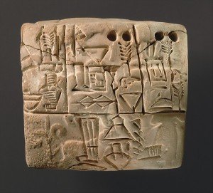 A tablet from Mesopotamia, circa 3100-2900 BC, depicting the distribution of barley. Image courtesy of the Metropolitan Museum of Art.