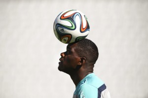 Portuguese national player William Carvalho tests out the new Brazuca ball before the World Cup. Image courtesy of the Washington Post.