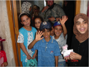 While on duty in Iraq, Ferry delivered supplies to the Al Amal Institute for Deaf Children, among serving other roles as a military physician. Image courtesy of Robert Ferry, Jr.