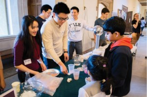 Yale undergraduate volunteers perform a demo for children at the first of this semester's Science on Saturdays. Photo by Suryabrata Dutta.