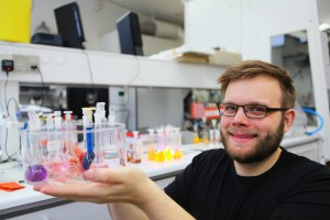 Dr. Sørensen with a collection of dyes that resemble the molecular building blocks used to make ordered nanomaterials and oriented thin films. (Image Courtesy of Jes Andersen/University of Copenhagen)