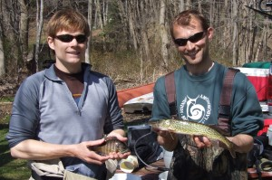 Researchers Andrew Jones (left) and Jakob Broderson (right) hold a sunfish and chain pickerel, respectively. Image Courtesy of Post Lab.