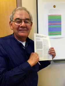 Rupp poses with the article he and Sancar published. Image courtesy of W. Dean Rupp.