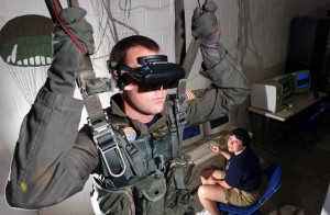A U.S. Navy officer uses virtual reality simulators to train for parachute missions. Image courtesy of Wikimedia Commons.