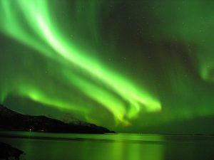1. The Earth's magnetic field is responsible for phenomenon such as the Northern Lights, which occurs when the sun's radiation is deflected by the magnetic field and collides with atmospheric particles. Image courtesy of Kristian Pikner, Wikimedia Commons.