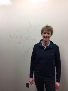 Dr. Pincet explains his research, utilizing the white board walls present at Yale's West Campus facility. Visible on the board is an explanation of activation energy along with an analysis of the kBT unit that was used to quantify that activation energy during the experiment. Image courtesy of Dr. Frederic Pincet.